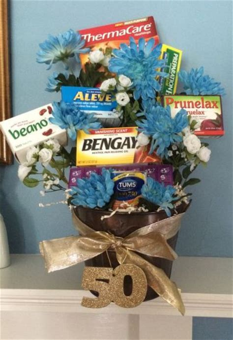 Gifts For 50 - age remedies tucked into a flower arrangement is a
