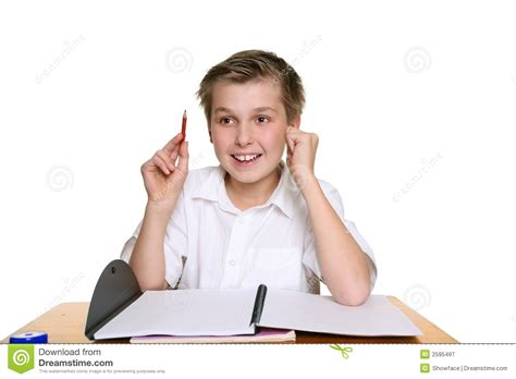 Student At Desk by Bright Happy School Boy Royalty Free Stock Photography