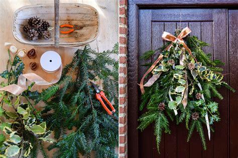 diy  evergreen festive swag   front door
