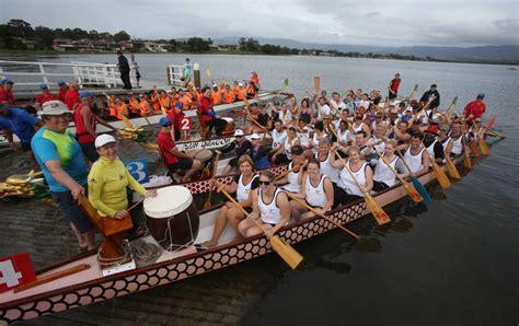 dragon boat illawarra hundreds compete in dragon boat races at oak flats bega