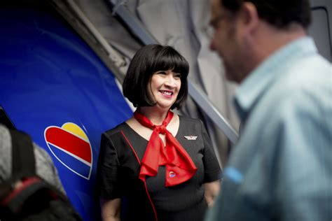 flight attendant wear bangs that runway look airlines restyle uniforms to balance