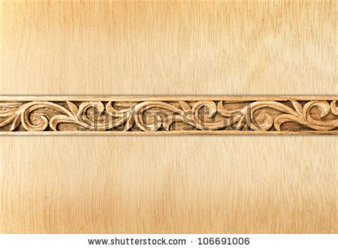 pattern of wood frame carved pattern of flower carved frame on wood background stock