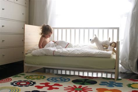 how to turn a crib into a toddler bed diy crib conversion into a mini daybed toddler bed