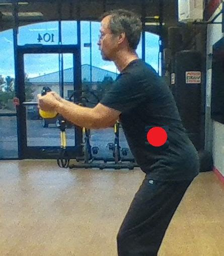 kettlebell swing lower back pain how to avoid back pain from kettlebell swings rkc school