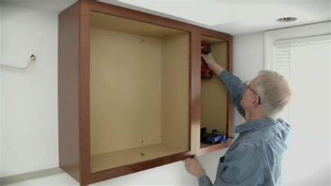 how to install upper kitchen cabinets installing upper cabinets fine homebuilding
