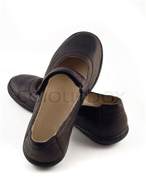 s black leather shoes white stock photo