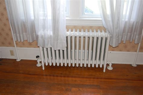 radiator room what s best replace radiator with heat hvac or heating help the wall