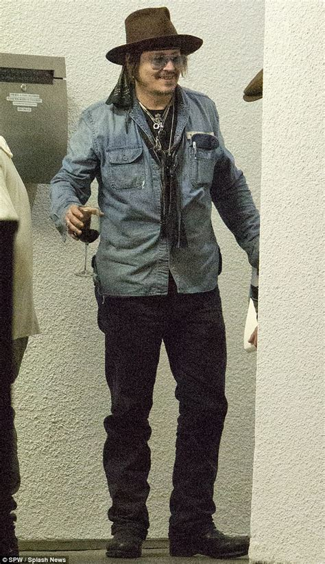 M K Takes Style Cues From Johnny Depp by Johnny Depp Takes Glass Of Wine Onto The Streets In La