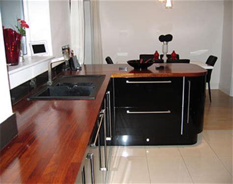 Kitchens Case Study   ultra modern gloss, iroko, and