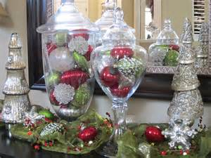 Ornaments can be displayed in glass bowls apothecary jars silver