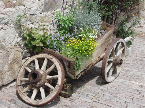 Wheel Barrow Planter by 27 Wheelbarrow Flower Planter Ideas For Your Yard