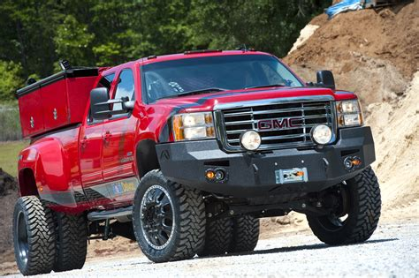 lifted gmc red red dualie gmc sierra commercial vehicle lifted duallies