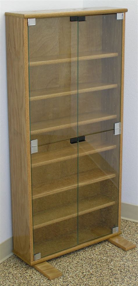 dvd bookcase with glass doors in oak or maple by decibel