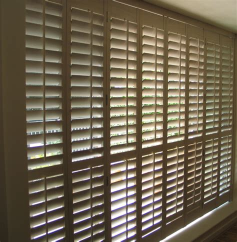 Wooden Shutters For Patio Doors Height Patio Door Shutters On A Tracking System 63mm Louvres Limed White Stained Wood