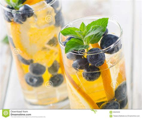 Detox Water With Blueberries by Detox Water With Orange Mint And Blueberries Stock Photo