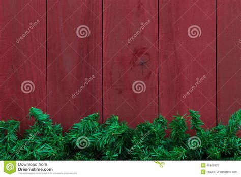 christmas evergreen tree garland border  antique red wood background stock photo image