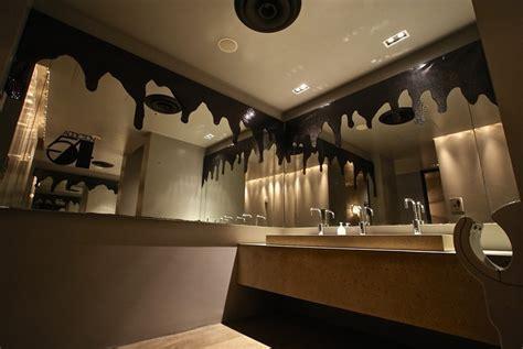 halloween bathroom decor in gold and black tones
