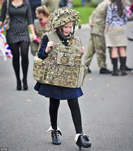 British Country Style - welcome home dads army excited children greet their fathers as royal artillery gunners return