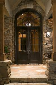 Mountain Works Home Design home front entrance doors with colonial window grid beside outdoor