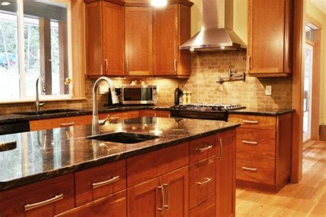 cherry wood kitchen cabinets with black granite 17 best ideas about cherry wood floors on pinterest