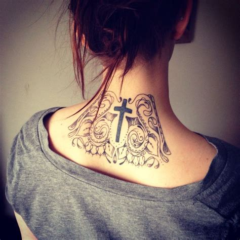 intricate cross tattoo back of neck with a cross in the center cool