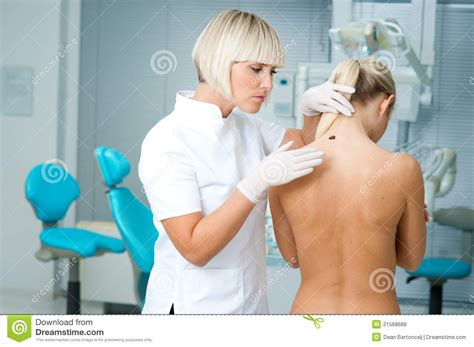 Doctor Examining Woman | doctor examining woman skin stock photo image of