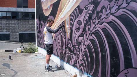 austrian street artist nychos unveils colossal mural