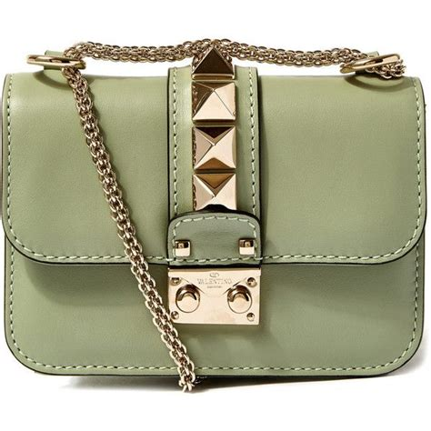 by modestcutie liked on polyvore featuring valentino valentino mini green rockstud shoulder bag 1 590 liked