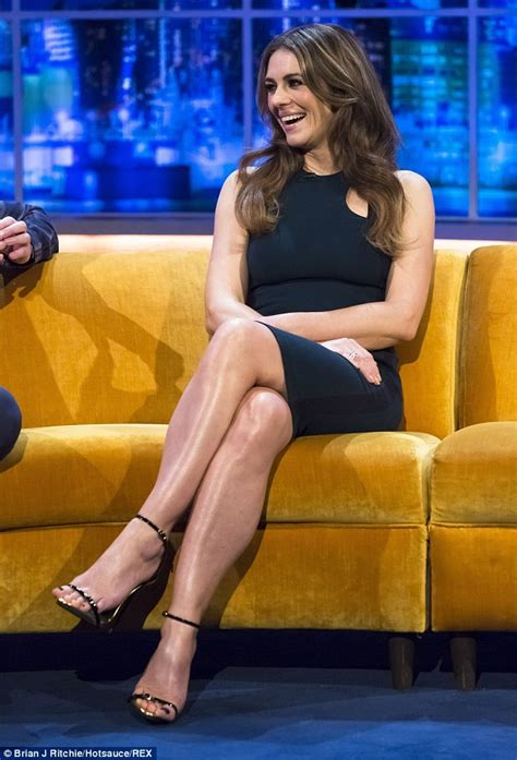Elizabeth Hurley talk show gorgeous legs in a navy curve