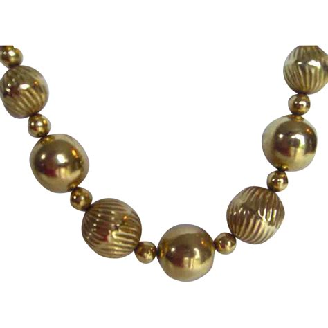 vintage gold toned beaded necklace from rozsplace on ruby