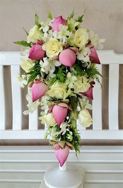 Pink lotus, White rose, White dendrobium orchid.   Flowers