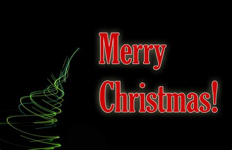 photo of merry christmas light on a dark background free
