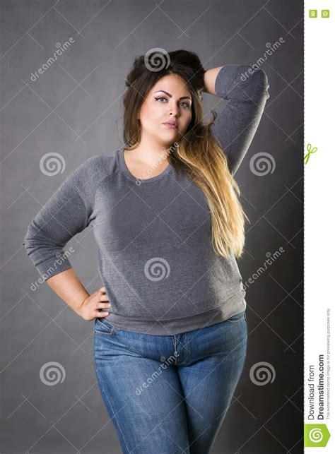 Plus Size Women Hair Models | young beautiful plus size model in blue jeans xxl woman