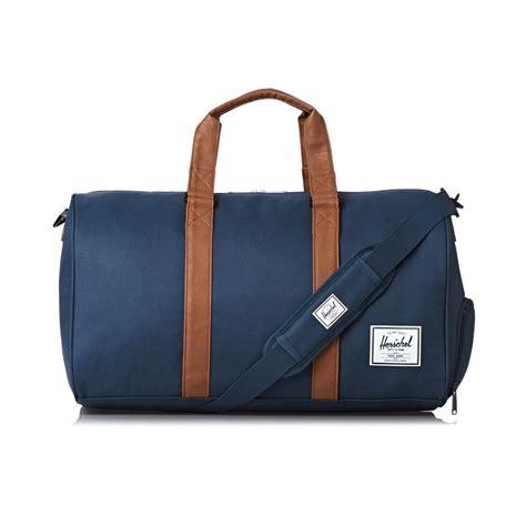herschel bags herschel novel duffle bag navy free uk delivery