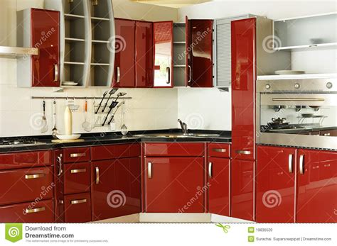 Luxury Kitchen Faucet by Modern Kitchen Cabinet Door A Deep Red 02 Stock Photo