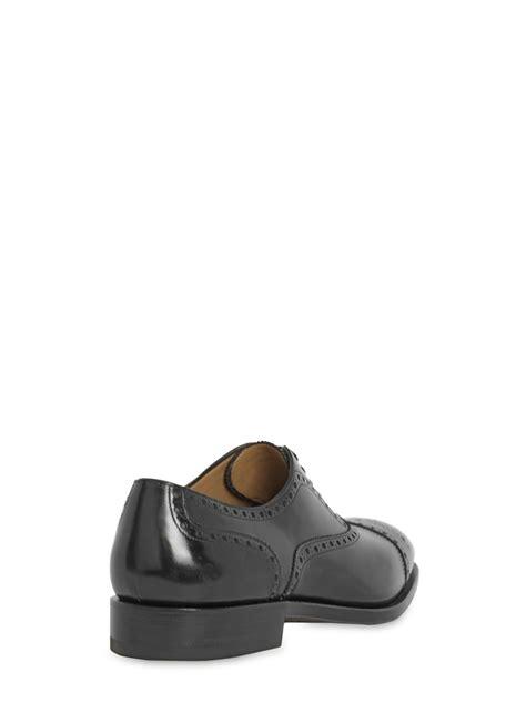 ferragamo montello tramezza brogue leather shoes in black