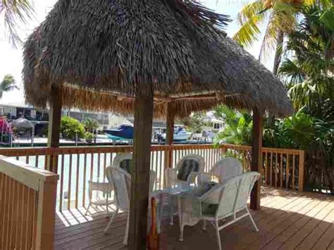tiki hut vacations on the water relax under the tiki hut on a beautiful deck by the water