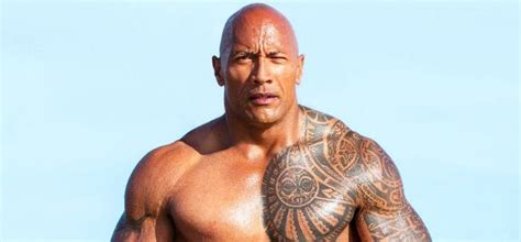 dwayne johnson getting tattoo dwayne the rock johnson s 3 tattoos their meanings