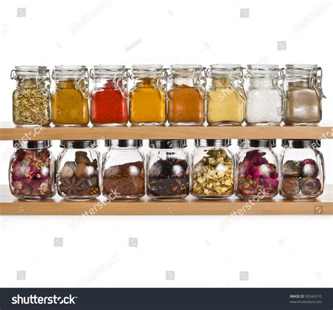 Shelf Of Spices by Powder Spices And Herbal Tea In Glass Bottle On A Shelf