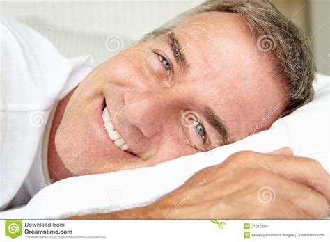 laying down in bed mid age man in bed lying down stock photo image 21012360