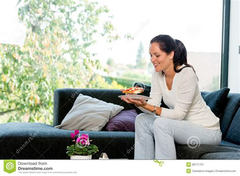 woman eats couch cheerful woman eating homemade sandwich living room stock
