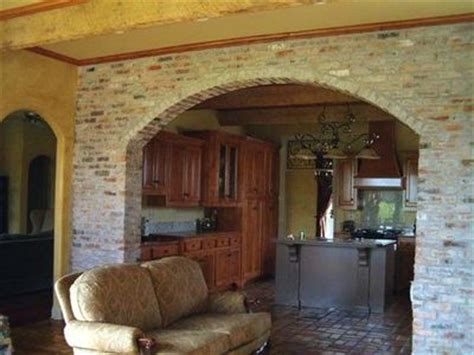 arch between kitchen and living room brick wall w arch will be between the living room and dini for the home juxtapost