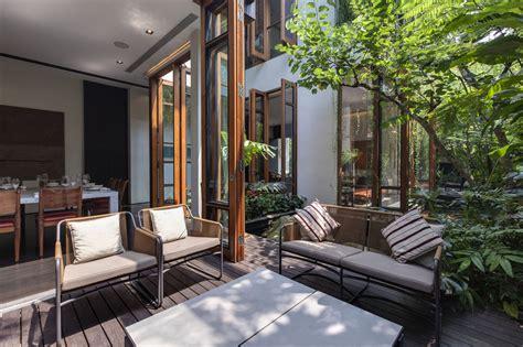 lush gardens and peekaboo roof pool define contemporary