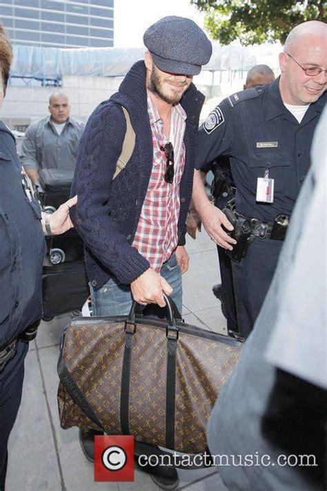 Louis Vuitton David Beckham With His Louis Vuitton Sac Squash And Pegase Luggage by David Beckham David Beckham Carrying His Louis Vuitton