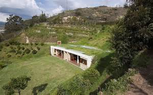 Dissolved into the landscape hillside home is virtually invisible at