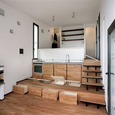 terraced studio with storage built into the stepped floor