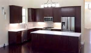 Beautiful cherry cabinets in remodeled kitchen with white tile