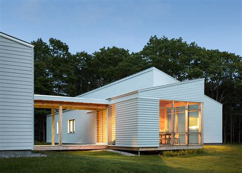maine home and design jobs go logic builds a wooden house in a forest clearing in maine