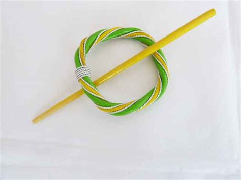 rattan and wire green and yellow circular shawl pin set