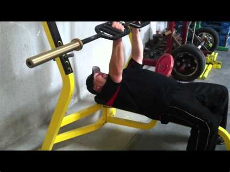 football bench press bar blast your pecs by bench pressing with the football bar